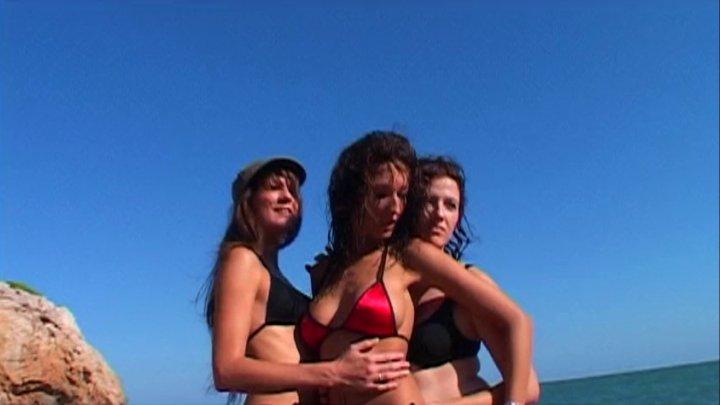Three sexy lesbians sluts masturbating on a beach